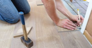 man measuring a floor 01