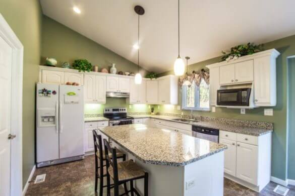 What to do with the Awkward Space Above Kitchen Cabinets